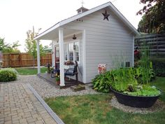 Love everything about this garden shed, water feature, tiny porch, and room for a potting bench along the side or back of shed.