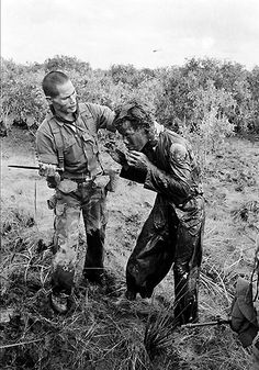 A South Vietnamese ranger uses the end of a dagger to administer punishment to a South Vietnamese farmer for allegedly supplying government troops with wrong information on Communist guerrillas during the Vietnam War, January 1964. (AP Photo/Horst Faas)