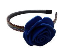 Blue color flower Hair-band (one flower), made of imported  rubber sheets, designed and crafted by village women, giving a   new fashion style to hair accessories.  Color: Blue   Material: Imported Rubber sheets   Base material: Imported plastic Hair-band