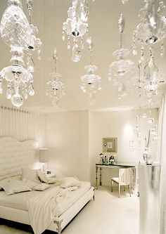 This neutral bedroom looks as pure as the driven snow....crystal, white bedding, minimal furnishings.