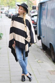Fashion blogger wearing Seraphine's striped maternity and nursing cover