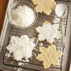 Coconut and a sweet glaze top these delightful White-Chocolate Snowflakes. More white chocolate desserts: http://www.bhg.com/christmas/recipes/decadent-white-chocolate-desserts/?socsrc=bhgpin110312whitesnowflakes