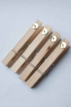 Hot glue tacks onto clothespins for an easy way to interchange artwork or anchor charts on a bulletin board. | 29 Clever Organization Hacks For Elementary School Teachers
