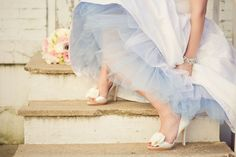 white d'orsay wedding shoes with blue tulle slip.