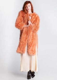 1970s 70s Studio 54 Maribou Coat Turn heads in this xxtravagant pink maribou coat. Features hook and eye closure and slits up each side.