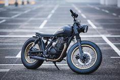 A stripped down Suzuki GN400 built by @ventusgarage. Less is more  Photo by @michalczelusniak.