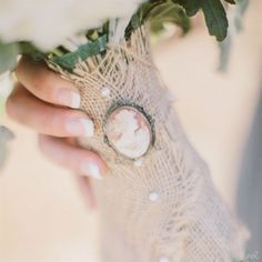 Burlap Bouquet Wrap with Vintage Cameo // photo by: Clane Gessel Photography // http://www.theknot.com/weddings/album/a-gray-and-yellow-rustic-wedding-in-hood-river-oregon-140620