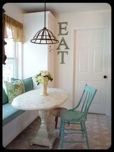 I like the burlap curtains and jolt of turquoise
