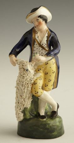 Staffordshire Figure, mid 19th c., of a man and a dog, H.- 7 1/4 in., W.- 2 3/4 in., D.- 2 1/2 in