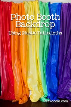 Photo booth backdrop using plastic tablecloths for a party - so easy! Rainbow baby