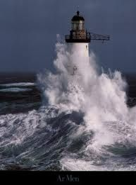 Lighthouse and crashing waves.I want to go see this place one day.