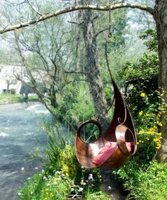 These are so cool.  Wonder how hot the metal one would get in an Oklahoma summer 15 Garden Swing Chair Ideas