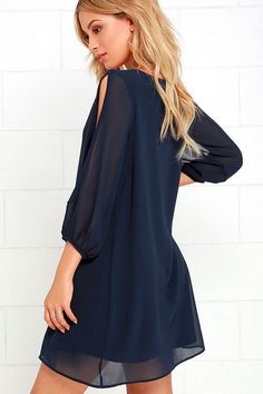 Lulus Exclusive! When it's time to shift your gears into glamor mode, the Shifting Dears Navy Blue Long Sleeve Dress is our most dearly beloved dress! Navy blue chiffon forms a roomy shift silhouette with a deep, scoop neckline and a flared shape that flows into an asymmetrical, concave hemline. Long, sheer sleeves have on-trend, cold shoulder cutouts that open all the way to the cuffs.