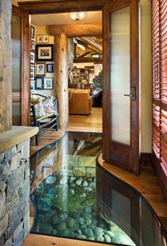 I don't care how impractical this is. I WANT IT. (House with creek running under it)