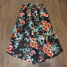 $10 Sale Black Floral High Low Skirt Great condition black skirt with coral and blue floral pattern. Skirt is lined to the shortest point. Elastic waist. From top to bottom is 28 inches. Waist laying flat and not stretched is 11 inches. Same day or next day shipping. No trades and no holds. 20% off of bundles. 100% Polyester. Joe Benbasset Skirts High Low