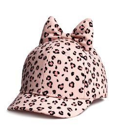 Cap in cotton twill with a printed pattern. Attached bow at 49c72bf355e