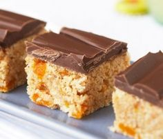 Apricot And Coconut Slice: This simple slice is bursting with apricots, and topped with a tempting layer of milk chocolate.