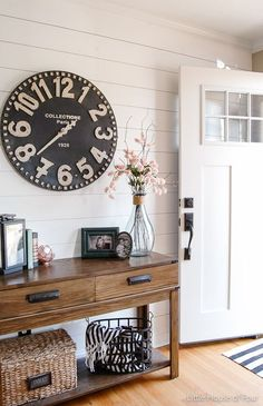 Ideas for how to hang a large or oversized clock as decor in an entryway or any room by Little House of Four