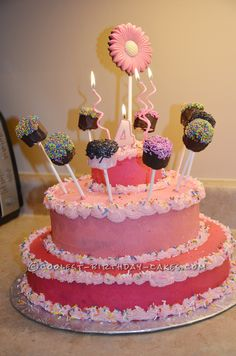 Coolest Princess Cake with Marshmallow Pops... This website is the Pinterest of birthday cake ideas