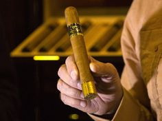 Obama Eases Special Limits On Cuban Products, From Drugs To Rum And Cigars --- An official displays a limited edition Cohiba 50 cigar, one of 2,000 made for the 50th anniversary of the Cuban brand, on the opening day of the annual Havana Cigar Festival in Havana, Cuba, in February. 2016.10