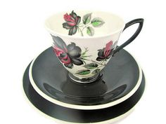 Royal Albert, Royal Albert Masquerade, Vintage China, Cup and Saucer, Tea Cups, Vintage China Trio, Black Floral Tea Cups, Collectible China A Royal Albert Masquerade vinatge trio of cup, saucer and side plate. This vintage trio from the Masquerade range dates back to the 1950s. The