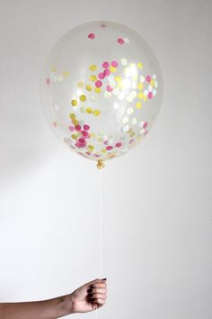 """Each balloon is hand filled with our in house confetti. Includes 1 """"17 inch crystal clear confetti filled balloon Have balloon inflated with helium at your local party store.  Confetti displacement will vary between balloons and must be fully inflated for desired effect. Colors: Mist Yellow Hot Pink Yellow  Confetti Balloon - Boardwalk by The Flair Exchange. Home & Gifts - Gifts - Odds & Ends California"""