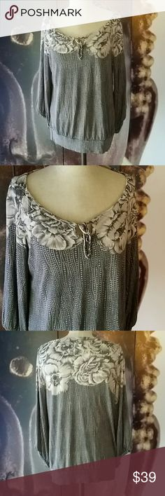 Anthropologie Deletta Floral & Dots Top Grey/black/white floral print cotton top. Bubble 3/4 sleeves. Very flattering and comfy. Size medium. EUC in nice preowned condition. No piling or stains. Missing the tassels. Anthropologie Tops Blouses