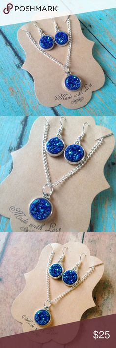 """Midnight blue faux druzy earring and necklace set This lovely necklace & earring set is sure to be an attention grabber. Druzy's are midnight blue in color and are super sparkly and eye catching! Size is 1/2"""" around. Earrings are dangle style. Comes with clear soft rubber backings for extra comfort. Necklace chain is 18"""". If you prefer a different length let me know and I'll adjust it for you. Nickel & lead free. Handmade by me & brand new. Bundle & save! Tags: Galaxy, boho, bohemian, fall…"""