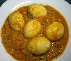 Eggs are perhaps the most versatile protein available which is a favorite among much of humanity. Apart from the fried, boiled, poached and scrambled eggs, some cultures like cooking them. The Sinh… Egg Curry, How To Cook Eggs, Scrambled Eggs, Rice Dishes, Chana Masala, Protein, Healthy Eating, Cooking, Ethnic Recipes