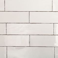 simple white subway tile in an updated more slender size keep it traditional but more modern