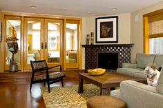 Mid Century Warm Living Room Design With Yellow Glass Panel Doors And White…