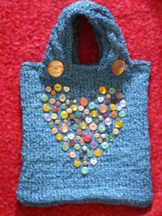 Recycled knitted plastic bag with vintage button trim