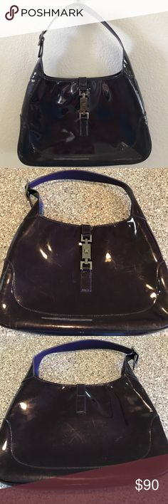 Gucci Patent Leather Purple Jackie Bag Used and authentic Gucci patent leather purse in purple. There are some scuffs on exterior of the bag. Minor interior tear, see pix.  Awesome bag for that purple lover!!! Gucci Bags