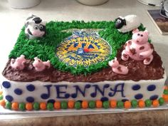 Buttercream FFA logo, on farm themed birthday cake with fondant farm animals