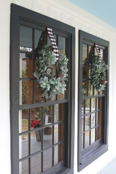 Black paned windows with Christmas Wreaths.