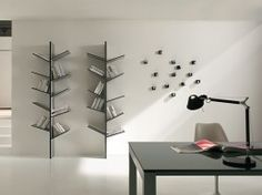 I love slanting bookshelves. The only problem is they don't hold a lot of books. :/