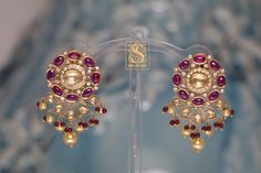 Gold plated silver earrings by Shaburis photo