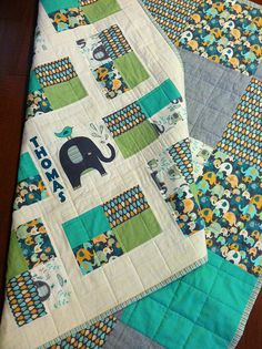 Elephant Splash baby boy quilt for Thomas. This fabric is too cute. I recreated the elephant and bird in applique. Thomas loves it!