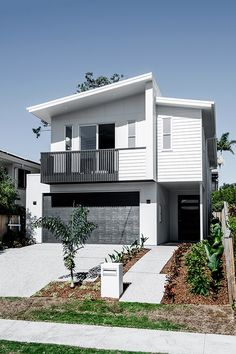 This mixed materials design puts a spin on the classic coastal home, using clean, crisp lines to achieve a modern finish. Perfect for a harbourside abode! Photo by: Cathy Schusler Home by: Kalka Homes Townhouse Exterior, Bungalow Exterior, Display Homes, Facade House, Modern House Design, Home Builders, Brisbane, House Colors, Exterior Design