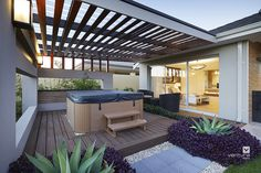 Alfresco patio backyard design. The Sanctuary display home by #VenturaHomes with its outdoor hot tub