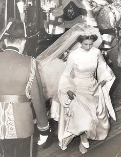 Princess Anne, the Princess Royal's First wedding in 1973 -- First look at the dress.  https://www.facebook.com/groups/260713314096465/