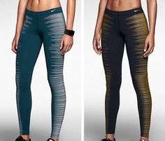 2 different color pairs of Nike running bottoms.