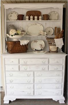 Certain painted kitchen cabinets have the ability to give your house a vintage country look. This State Fair Farmhouse Cupboard is definitely one of those kitchen or living room ideas. All you need is an old cupboard, and this tutorial will show you how to distress furniture with paint.