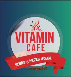 Vitamin Cafe backlit signpost