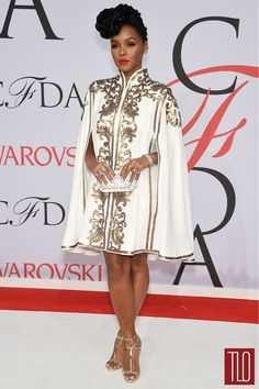 anelle Monáe, in a Tadashi Shoji gold-embroidered cape dress, attends the 2015 CFDA Awards at Lincoln Center in NYC
