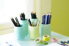 Alternatively, you could always paint the inside of the jars to provide a glossy finish.   These are great for storing utensils or craft supplies. Get the full tutorial here.