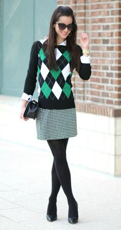 Love how well this black and green argyle sweater pairs with a white oxford shirt, classic geo print mini skirt, and black tights. Mixed patterns and preppy holiday outfit inspiration at their finest.