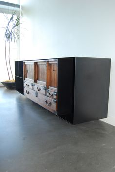 Hot Rolled Steel cabinet that was specifically designed to house an antique Tansu Cabinet.  Designed by Eggleston/Farkas Architects