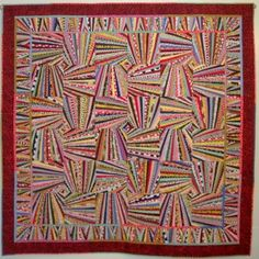 This is similar to a selvage quilt but she talks about her technique is creating this quilt. By..there is not an author posted selvageblog.