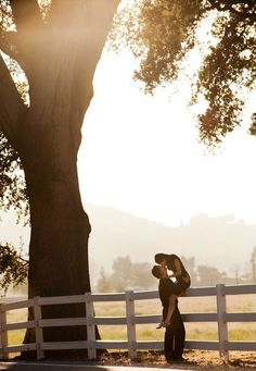 photo by Los Angeles wedding photographer Roberto Valenzuela - gorgeous engagement photo with happy couple kissing in rustic landscape